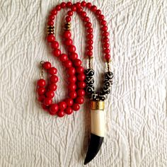 Fashionable pendant necklace.  Great for SEC game day!  Go dawgs!  This can be yours, visit for Eloise at foreloise.com   #pendant #necklace #horn #redandblack #SECfootball #UGA
