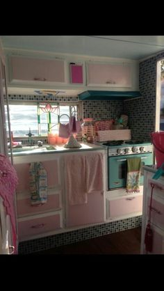 Love the two tone cabinets (doesn't have to be pink) with the glass tile back splash