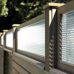 Give extra interest to a traditional privacy fence by topping it with a contrasting panel. Standard lattice panels can do the job, or make your own unique design by using perforated aluminum panels framed in matching cedar.