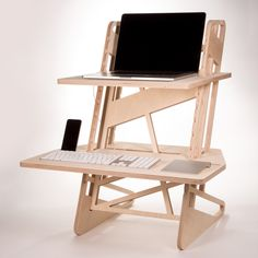 Standing desk converter CNC cut from European Birch plywood. Completely tool-less assembly.