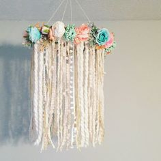 Definitely loving this mobile!! It is the 2nd version of a floral mobile that Ive done and just has a different color scheme to the florals. This dreamcatcher mobile is perfect for a baby girls nursery!! The neutral color fabrics & soft pastel floral colors will coordinate beautifully with most décor. Boho chic with its assortment of yarns, flowers and greenery. The base is wrapped in cream ruffle yarn with a cream twine hand woven authentic web. The base is large size at 10 inches wide a...