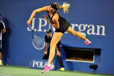 Maria Sharapova follows through on a serve during her first-round match against Maria Kirilenko