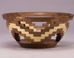 This is a segmented bowl done in a stave style construction. It is made out of Walnut and Maple and is approximately 9 inches by 6 ½ inches tall. It has a very unique style that everyone seems to like.