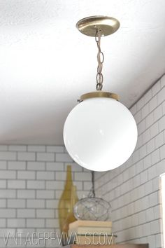 Upcycled thrift store lighting in a kitchen remodel