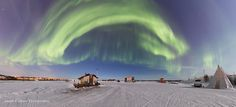 The Arch - Northern lights arching above the houseboats of Yellowknife Bay.