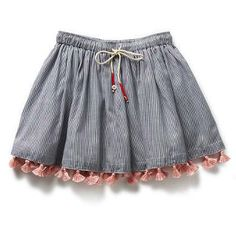 make simple circle skirt with elastic waist band, tassel drawstring maybe and add tassels to the bottom for added flare