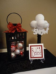Lantern filled with ornaments ...cute!  IKEA has these lanterns super inexpensive too!
