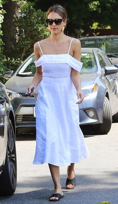 Jessica Alba in a white off-the-shoulder Reformation midi dress - click ahead for more summer outfit ideas from celebrities