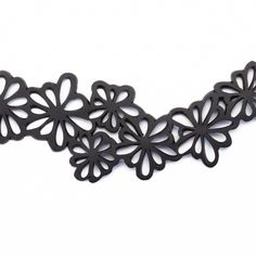 Our Dahlia Recycled Rubber Statement Flower Choker is not only eye-catching, but its also comfortable to wear due to the soft and tactile texture of rubber. Tactile Texture, Flower Choker, Bike Chain, Dahlia Flower, Recycled Rubber, Plastic Bottles, Upcycle, Unique Jewelry, Tube