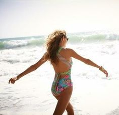 This Trina Turk swimsuit is simply beautiful. Smitten with the crisscross back and brightly colored print.