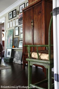 Love this floor to ceiling gallery wall -  beautiful living room decorated for fall eclecticallyvintage.com