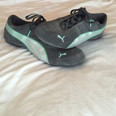Worn once! Puma sneakers Very good looking sneaker that is dark gray and a mint green. Worn once bc needed them for a short event but have not caught myself wearing any sneaker since. Size 10 Puma Shoes Sneakers