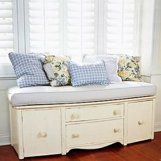 Creative way to repurpose a dresser. Cut off the legs, add an upholstered seat and pillows to turn it into a bench.