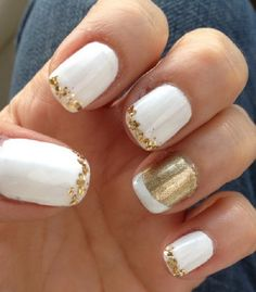 White nail art design wth gold french tips. The french tips are decorated in small gold embellishments and a reverse design on one of the nails with gold glitter and white polish as french tip. Gold Nail Designs, Fingernail Designs, Short Nail Designs, Simple Nail Designs, Acrylic Nail Designs, Nails Design, Gold Nail Art, White Nail Art, Gold Nails