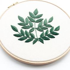 This Hand Embroidered Hoop features a contemporary leafy design- this is of Aralia Spinosa which has been made using DMC Embroidery Threads and has been embroidered on to high quality Cotton/ Linen Mix fabric creating a modern finish. This has been framed in a 9 Inch Hoop. Each design is unique and has been made by hand, I adore making these so if you would like a different colour scheme or a different plant/ flower/ succulent just send me a message! This particular design is Aralia Spinosa…