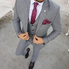 grey three piece suit with red tie and pocket square.Men's grey three piece suit with red tie and pocket square. Mens Fashion Suits, Mens Suits, Men's Fashion, Suit With Red Tie, Prom Suits With Red, Prom Suits For Men, Grey Suit Combinations, Grey Suit Wedding, Men Wedding Suits