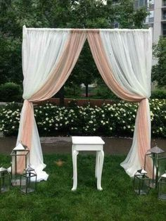 White-blush backdrop for ceremony