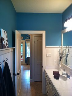 wainscoting, wh cabinet,  marble counter- blue bathroom