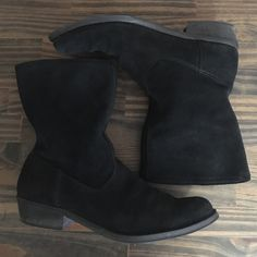 Nine West Boots Black Nine West Black Suede Midi Boot size 7. Tag Reads Leather Upper/Manmade Sole. These boots are in Great Used Condition, please refer to pictures. Also listed in Taupe. Ready for Skirts and Shorts? Please look at pictures Closely and ask any Questions prior to Offer or Purchase if Unsure. Nine West Shoes Heeled Boots