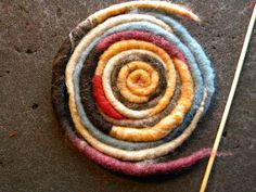 Twisted wool roving worms DIY ... http://plotfiftyfive.blogspot.com/2012/02/twisted-wool-roving-worms.html