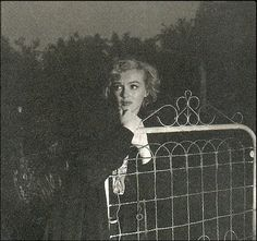 "Monroe called Andre de Dienes late one night unable to sleep and in the grip of a dark depression.He picked her up and they took these shots in the dingy back alleys of the Hollywood hills. The cars headlights light the shots. Monroe told de Dienes to title the shots ""The End Of Everything"" (1953)."