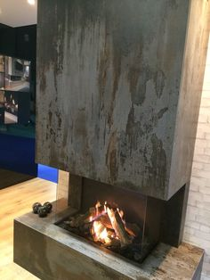 Dekton is the ultimate surface for your renovation. Trilium adds an industrial look to your space, but won't crack or fade due to high heat. Metal Fireplace, Fireplace Surrounds, Fireplace Design, Wall Design, House Design, O Gas, Visual Texture, Corrugated Metal, Building A New Home