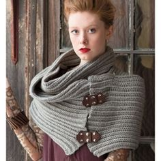 Design by Cristina Mershon  Oversized wrap worked in raised half-double crochet ribs and finished with leather closure.