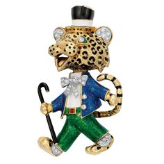 Gold, Enamel and Diamond Leopard Brooch  The jolly leopard dressed as a dandy, outfitted in a blue, white and green enameled suit, with a top hat and cane, his bow tie, ears, eyes, buttons and feet accented by 35 round and single-cut diamonds, approximately 24.6 dwt.