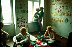 Punks in squatted flat East-Berlin 1982 by Ilse Ruppert