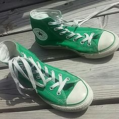 Green High tops Converse These hightops have been used a few times. they're a little dirty, and 2 ends of the shoelaces are frayed but these have a lot more wear to them. They're cute and really stand out in a good way. The line going around the toe and side is green instead of black. US Womens 8, US Mens 6. Converse Shoes Sneakers