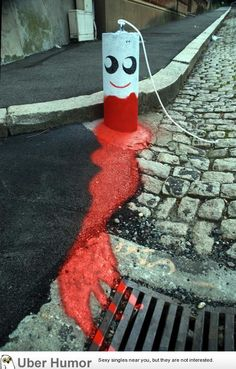 Concrete barrier painted as tampon street art. Kind of cute, really.