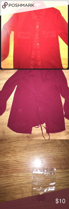 Pretty Maroon shirt! ❤️❤️❤️😍 Pretty maroon shirt with gold details on the button tied up in the back to give you that form fitting looking good quality material slightly sheer  great for that business casual look for work or just to wear out very versatile I have an extra button to go with it as well as pictured purchased at papaya Papaya Tops Button Down Shirts