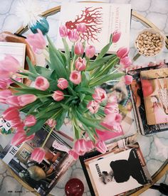 flowers on a coffee table with books