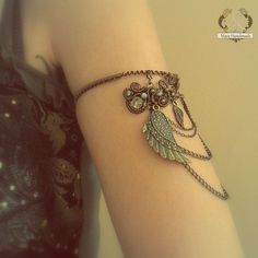 Victorian Upper Arm Cuff Bracelet/Armlet With Chains, Wings And Gemstones. $50.00, via Etsy.