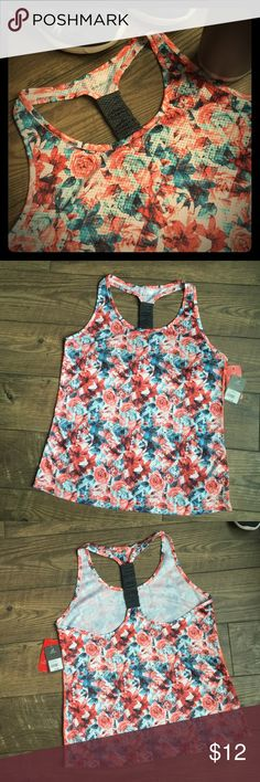 BCG Tank NWT beautiful floral performance tank. Try-Wick for quick dry on those long runs. Reflective to increase night visibility. Very cut cut! BCG Tops Tank Tops