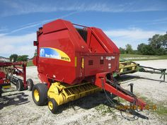 Bright red new Holland BR7070 round baler in Huntington