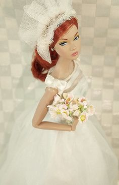 Poppy models a modern wedding gown from Tiny Frock Shop