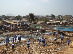 A contaminated river runs through the valley in Freetown, Sierra Leone, where there is neither sanitation nor garbage collection. Children from the nearby Kroo Bay primary school play amid the trash. Kids Around The World, Places Around The World, Around The Worlds, Playground Photography, Nature Photography, Sierra Leone, British Schools, Playground Design, Children Playground
