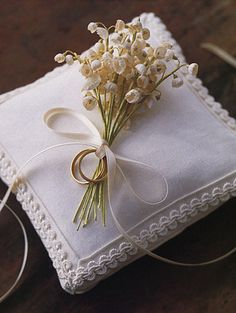 ring pillow with lilies of the valley