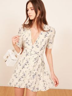 so into delicate florals for spring Reformation Lucky Dress (affiliate) - Never met a wrap dress we didn't like. This is a mini length wrap dress with a v neckline. Elegant Dresses, Cute Dresses, Casual Dresses, Short Dresses, Wrap Dresses, Wrap Dress Short, Wrap Dress Floral, Boho Dress, Dress Skirt