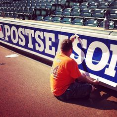 Postseason banners go up at Camden Yards. Go, Orioles!