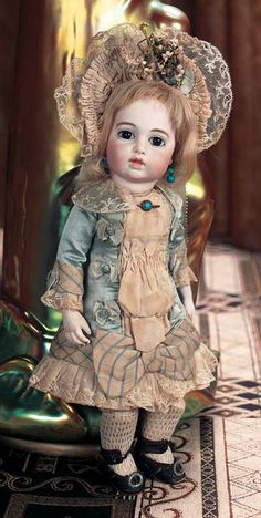 "13"" (33 cm.) Bisque swivel head on kid-edged bisque shoulder plate,,French kid bebe body with gusset-jointing,bisque forearms.  Marks: (circle/dot symbol) 2. Comments: Leon Casimir Bru,circa 1882.  Theriault's Antique Doll Auctions"