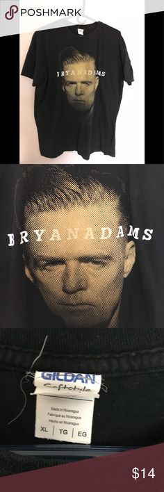 """Bryan Adams 2015 Tour Tee Bryan Adams 2015 Reckless Tour t-shirt. Graphics on both sides. Good condition!  Pit to Pit 22"""" Length 28"""" T-shirts in my closet are *preowned* unless specified otherwise. I will do my best to point out any flaws,etc, but please check out my pics closely before purchasing. Feel free to ask questions or request more pics. Thanks! Gildan Shirts Tees - Short Sleeve"""