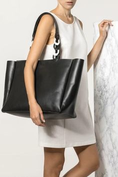 Classy black tote bag handmade of fine quality calf leather features our signature chain top handle. A timeless piece, Estia boho-chic design will be your perfect companion on busy days in the city, matching with innumerable looks and colors. The shopping bag comes in 4 black and white, black, nude (nubuck) and camel (waxed tan). Greek Chic Handmades bags are designed and handcrafted in Athens, Greece from the same premium leather we built the sandals with and the impeccable local… Large Leather Tote Bag, Black Leather Backpack, Black Tote Bag, Leather Bags, Calf Leather, Tote Bags Handmade, Athens Greece, Shopping Bag, Vestidos