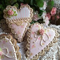 Pale pink Valentine hearts with crocheted ivory lace, painted country roses, pink roses, pearls by Teri Pringle Wood
