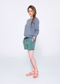 Match a soft, blue-and-grey fleece with delicate white polka-dots with a pair of dark green fleece shorts - it's the perfect look for those long Spring afternoons at the park. SUN68 Woman SS15 #SUN68 #SS15 #woman #shorts #sweater