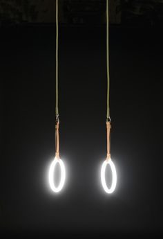 GYM LIGHTS by Sarah Illenberger. Pair of fluorescent lamps, rope, leather, steel. Gym Lighting, Lighting Design, Pendant Lighting, Light Art, Lamp Light, Neon Rosa, Ring Lamp, Gym Interior, Lampe Decoration