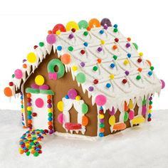 """Sweet Shelter Gingerbread House - Just follow the colorful walkway to a house that just shouts, """"happy holidays."""" Bright gum drops and candy rounds add fun awnings and 3-D windowsills to this sweet little silhouette."""