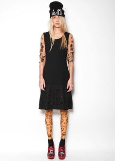Laser cut dress worn upon tattoo top and collant