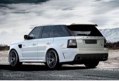 White Range Rover Sport. Get some better wheels on that bad boy and it's on point!